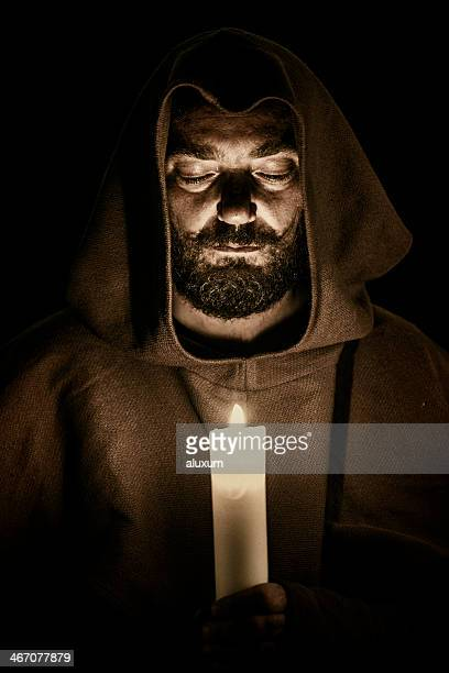 Monk with candle