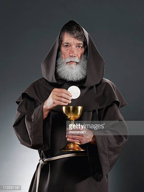 monk with chalice and host, portrait - monk stock pictures, royalty-free photos & images