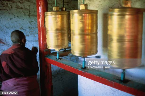 monk with prayer wheels - eric van den brulle stock pictures, royalty-free photos & images