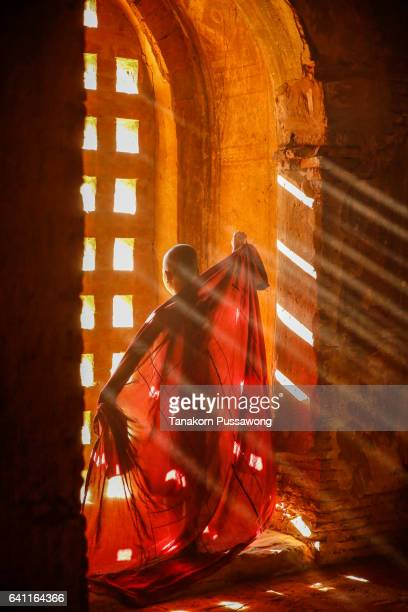 Monk with sun light from outside to inside