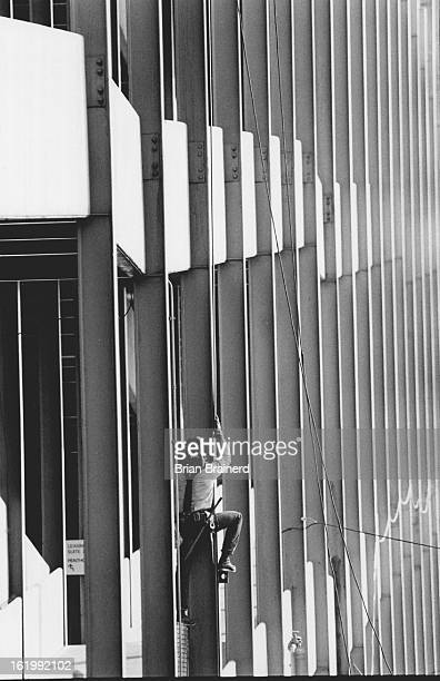 FEB 27 1986 FEB 28 1986 Monkey Bars Ironworker Bob Watson climbs on the outside of Mile High Stadium Thursday He was attaching reenforcement to...