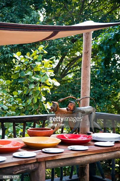 Monkey statues on the breakfast table at Samode Safari Lodge near Bandhavgarh National Park India