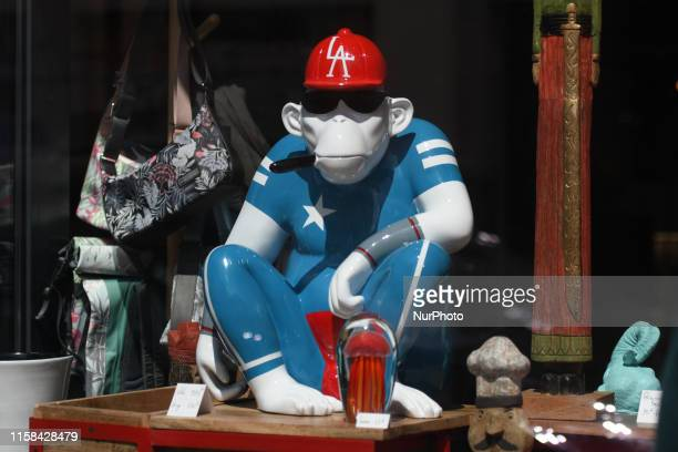 A monkey statuette seen in a shop window in Granville center On Sunday July 28 in Granville Normandy France