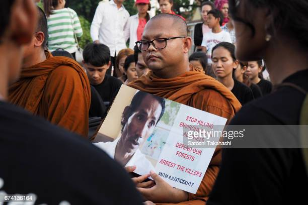 Monks and activists pay their respects to slain prominent environmental activist Chut Wutty during a commemoration rally for the fifth anniversary of...