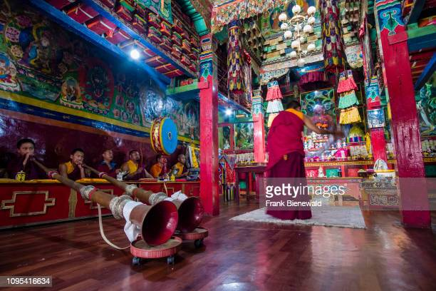 Monks are praying during a ceremony in the monastery in the town in Kali Gandaki valley