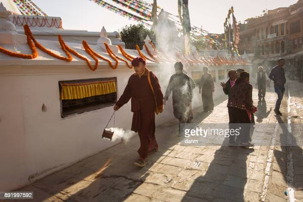 Monks around Boudhanath stupa. The Buddhist stupa it is one of the largest stupas in the world