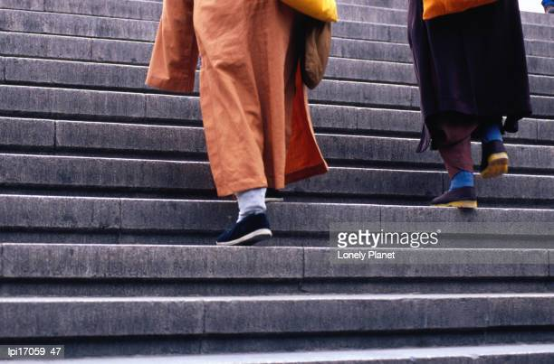 Monks ascending stairs in Dongcheng district.