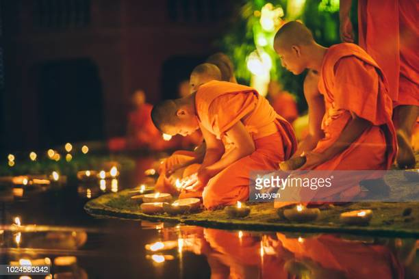 monks at phan tao temple during the loi krathong festival - loi krathong stock photos and pictures