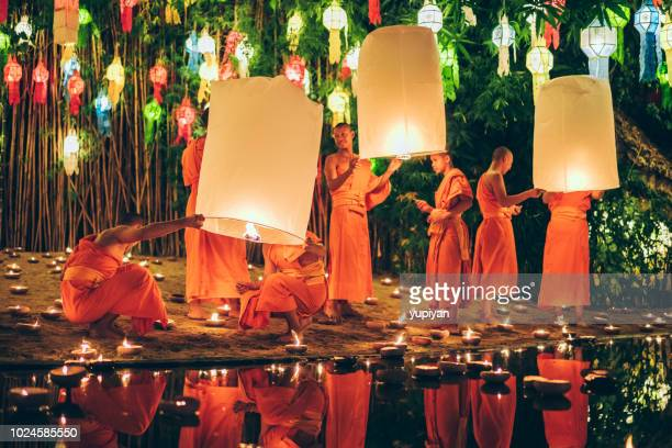 monks at phan tao temple during the loi krathong festival - chiang mai province stock photos and pictures