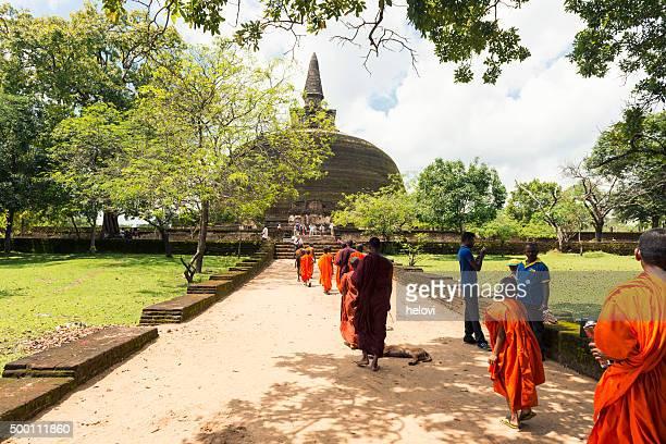 monks at rankot vihara in polonnaruwa - sri lankan culture stock pictures, royalty-free photos & images