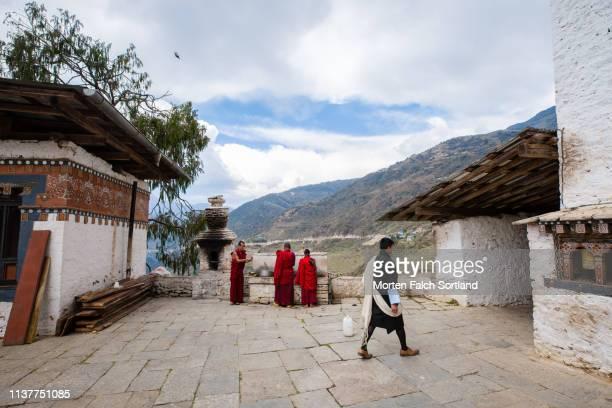 monks busy at work in trongsa, bhutan - trongsa district stockfoto's en -beelden