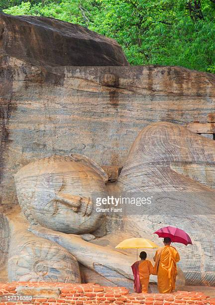 Monks by huge buddha.