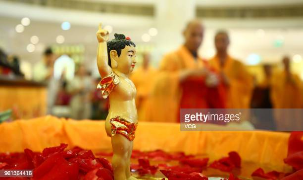 Monks chant before bathing the statue of buddha to mark the 2,562nd birthday of Buddha on the eighth day of the fourth month in Chinese lunar...