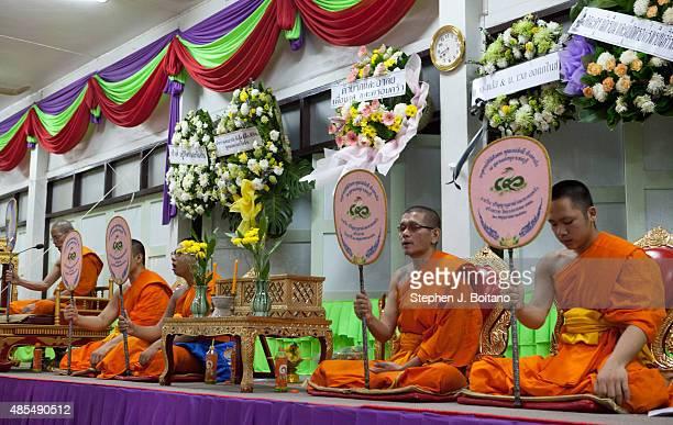 Monks chant during funeral services for Yutnarong Singro at Wat Bangna Nok in Bangkok Thailand. Three days after a bomb exploded killing him close to...