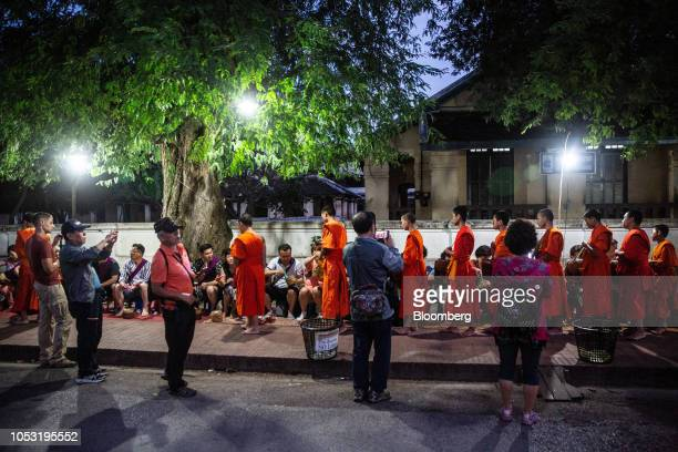 Monks collect alms from tourists and locals at a ceremony in Luang Prabang Laos on Monday Oct 22 2018 Laos's economy is set to expand at 7 percent...