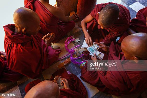 Monks counting money in Shwezigon Paya