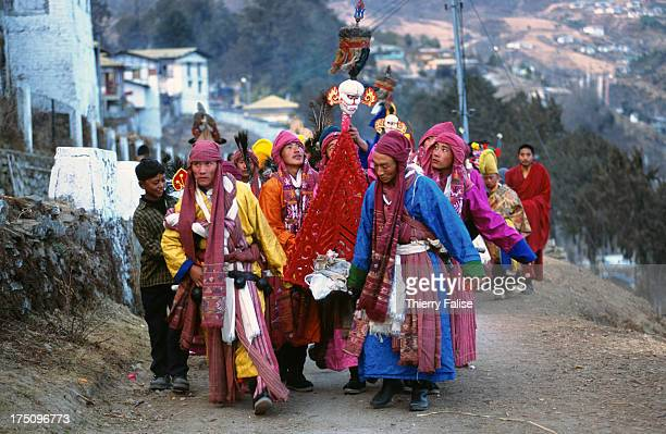 Monks dressed in ceremonial cloth carry a thorma a pyramid made from millet flour and butter during the Torgya festival The pyramid will later be...