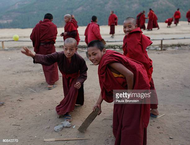 Monks enjoy some free time playing cricket between classes at the Dechen Phodrang monastery April 2 2008 in Thimphu Bhutan About 475 monks reside at...