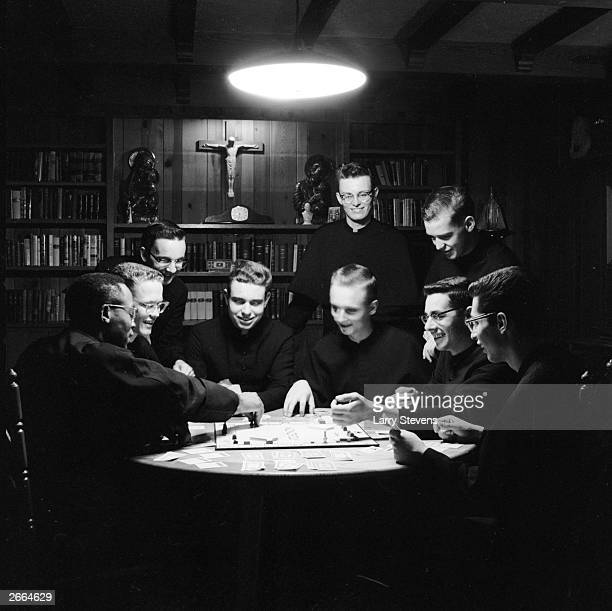 Monks enjoying a game of Monopoly.