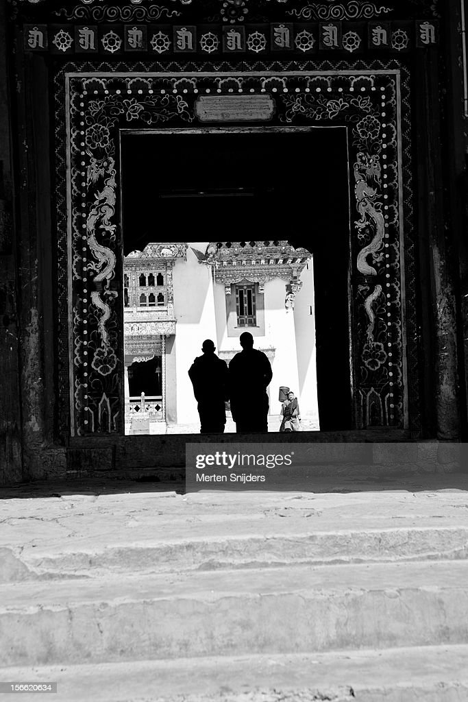 Monks entering Gangtey Monastery : Stock Photo