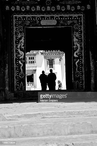 monks entering gangtey monastery - merten snijders stock pictures, royalty-free photos & images