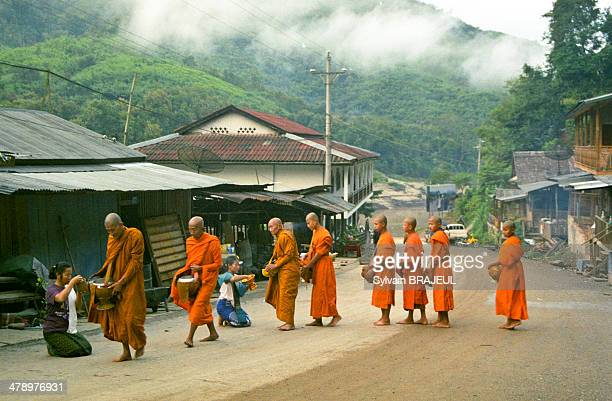 CONTENT] Monks food offerings Pakbeng Laos