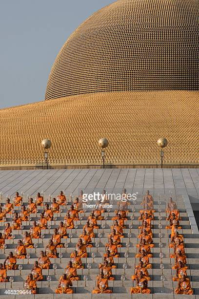 Monks from Dhammakaya temple's gather around the so-called Cetiya for a mass meditation ceremony during Magha Puja day, one of the main Buddhist...