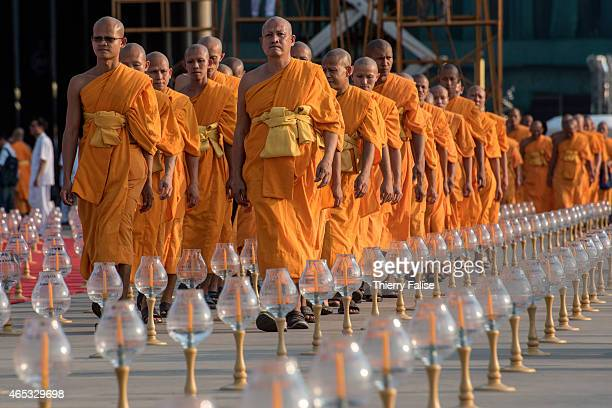 Monks from Dhammakaya temple's walk to a mass meditation ceremony ground during Magha Puja day, one of the main Buddhist celebrations. Dhammakaya...