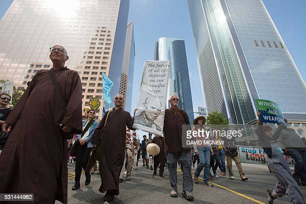 Monks from the Deer Park Monastery in Escondido California walk in the March to Break Free from Fossil Fuels on May 14 2016 in Los Angeles California...