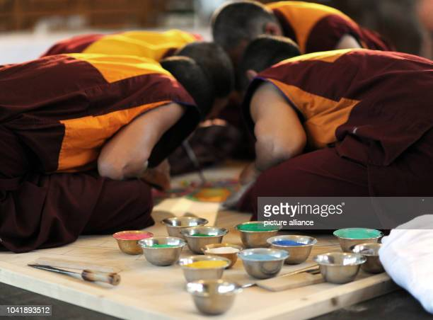 """Monks from the exile cloister """"Sera Jhe"""" inSouth India work on a three meter large sand mandala at the Ethnological Museum inHamburg, Germany, 15..."""