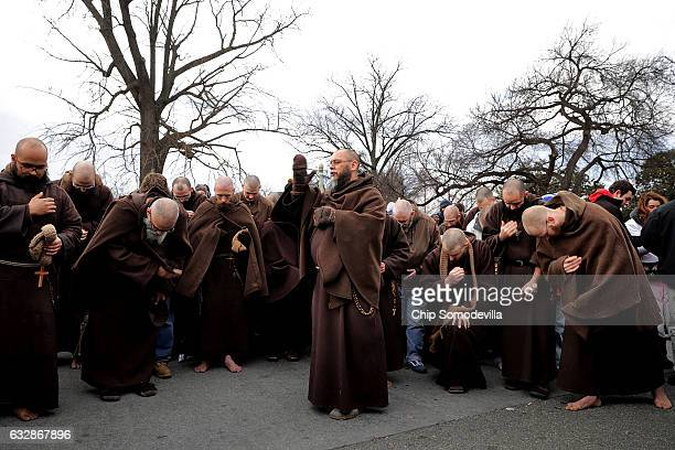 Monks from the Franciscan Friars Minor of Fort Wayne IN pray in the street in front of the US Supreme Court building during the 43rd annual March for...