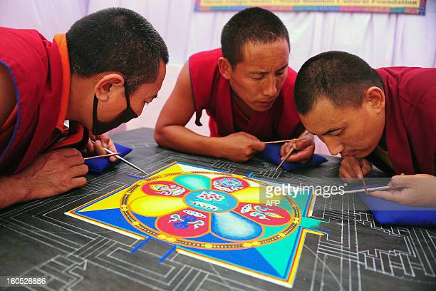 Monks from the Himalayan Buddhist Culture Association prepare a sand mandala as they prepare for the arrival of Tibetan spiritual leader The Dalai...