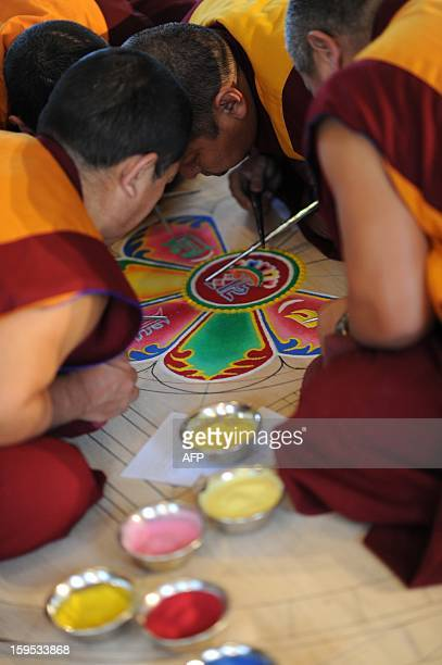 Monks from the monastery in exile Sera Jhe in South India make a nearly threesquaremeter sand mandala on January 15 2013 at the Ethnographic Museum...