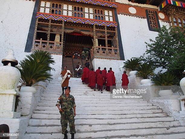 CONTENT] Monks going up the steps to enter the Punakha Dzong