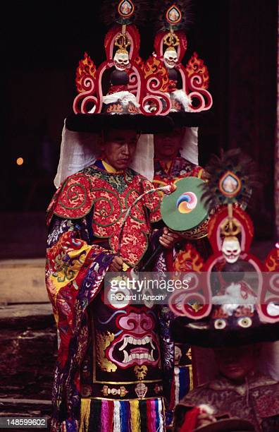 monks in elaborate costume performing ritualistic dance at the mani rimdu festival at chiwang gompa (monastery). - mani rimdu festival stock pictures, royalty-free photos & images