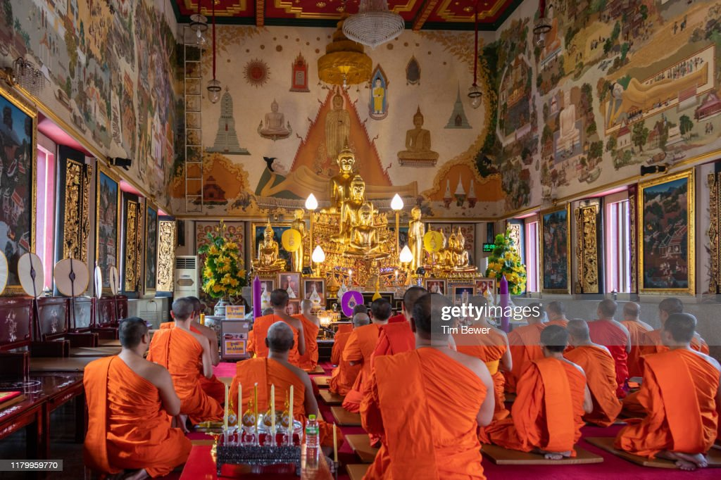 Monks in front of Buddha image. : Stock Photo