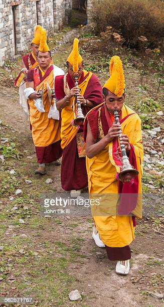 monks in procession on temple grounds - mani rimdu festival stock pictures, royalty-free photos & images