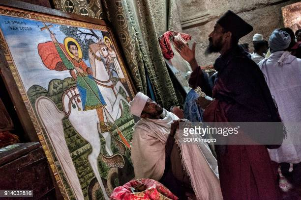 Monks inside the Biete Giyorgis in Lalibela During the first days of January thousands of Ethiopian Orthodox Christian pilgrims go to the city of...