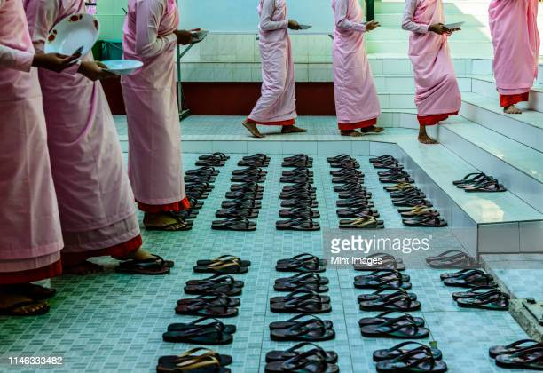 monks leaving sandals near staircase - cult stock pictures, royalty-free photos & images