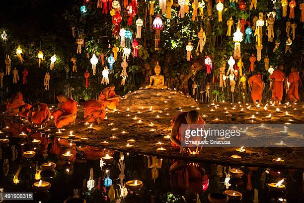 CONTENT] Monks lighting candles in preparation for the Loi Krathong celebration at Wat Pahn Tao a Buddhist temple in Chiang Mai Thailand