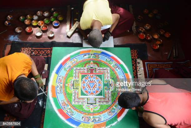 Monks make mandala with using natural colours for the prayer for their spiritual Guru Kyabje Taklung Tretrul Rinpochhe who was mummified in the...