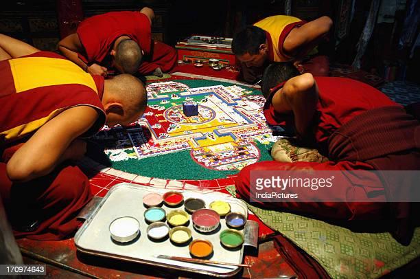 Monks making mandala, Ladakh, Jammu and Kashmir, India.