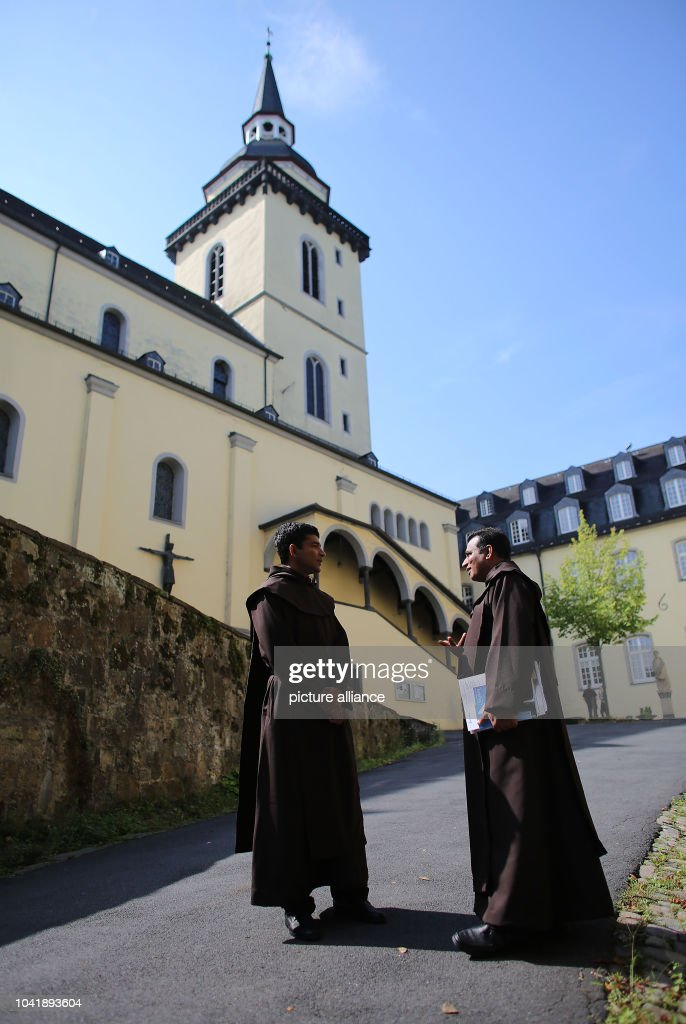 Monks of the Discalced Carmelites stand in front of the Michaelsberg