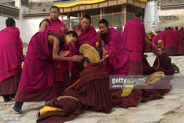 Monks of the Gelugpa sect during debate session Labrang Monastery Gansu Province China Labrang Monastery is one of six monasteries of the Geluk...