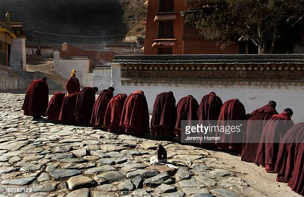 Monks of the Gelugpa sect in debate session Labrang Monastery during Tibetan New Year celebrations Gansu Province China Labrang Monastery is one of...