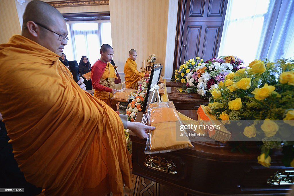Monks offer garments at a service of remembrance for three Thai Buddhist Monks who died in a car crash on Christmas Eve, at Oakvale Funeral Home on January 2, 2013 in Edinburgh, Scotland. Abbot Phramaha Pranom Thongphaiboon, 43, head of the Thai Buddhist community in Aberdeen, was killed in a car crash on Christmas Eve along with his colleagues Phramaha Kriangkrai Khamsamrong, 35, and Phramaha Chai Boonma, 36. The three men were travelling to the Dhammapadipa Temple in Edinburgh when they were involved in the head-on collision on the A68 near Pathhead, Midlothian.