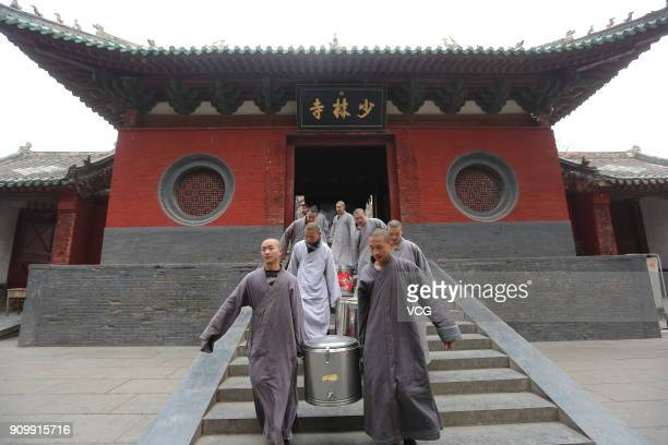 Monks offer Laba porridge for citizens at Dengfeng Shaolin Temple during Laba Festival on January 24 2018 in Dengfeng Henan Province of China The...