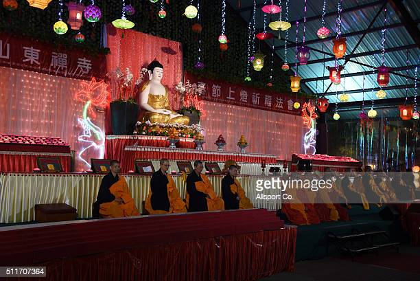 Monks offer prayers near a Buddha statue at the Fo Guang Shan Dong Zen Temple to celebrate the Lantern Festival on the last day of Chinese Lunar New...