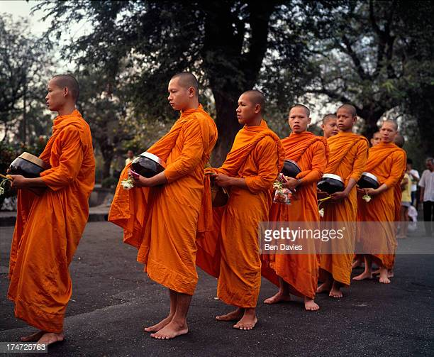 WAT BENCHAMABOPHIT BANGKOK THAILAND Monks on their early morning alms round near Wat Benchamabophit widely known as the Marble temple in Bangkok the...