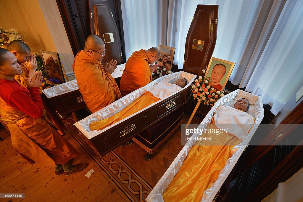 Monks pary over the open coffins at a service of remembrance for three Thai Buddhist Monks who died in a car crash on Christmas Eve, at Oakvale Funeral Home on January 2, 2013 in Edinburgh, Scotland. Abbot Phramaha Pranom Thongphaiboon, 43, head of the Thai Buddhist community in Aberdeen, was killed in a car crash on Christmas Eve along with his colleagues Phramaha Kriangkrai Khamsamrong, 35, and Phramaha Chai Boonma, 36. The three men were travelling to the Dhammapadipa Temple in Edinburgh when they were involved in the head-on collision on the A68 near Pathhead, Midlothian.